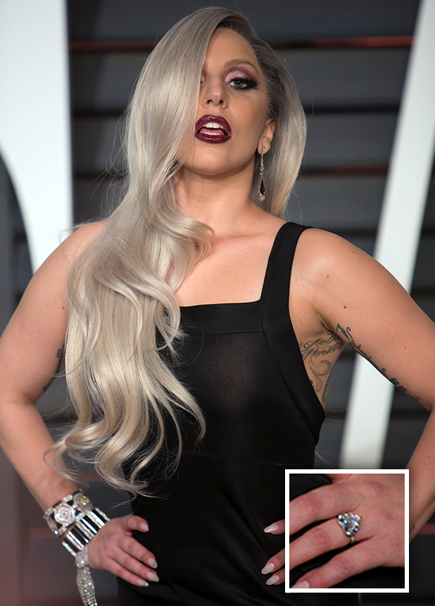 http://www.reveal.co.uk/showbiz-celeb-gossip/news/a630868/lady-gaga-flashes-heart-shaped-engagement-ring-at-oscars-after-party.html